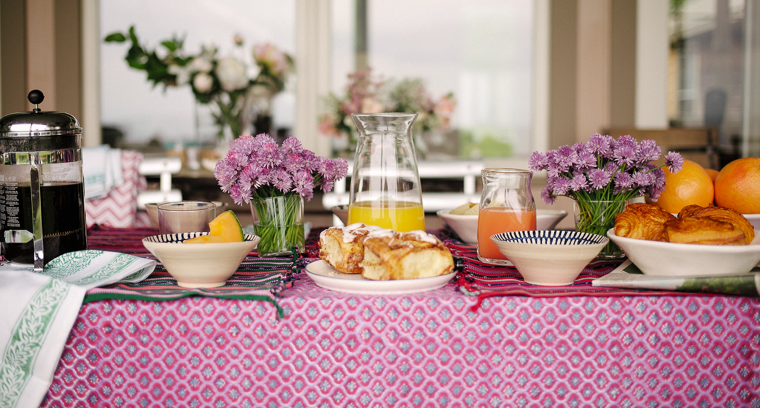 Table setting by Lucy Cuneo using Wicklewood tablecloths, placemats and ceramics