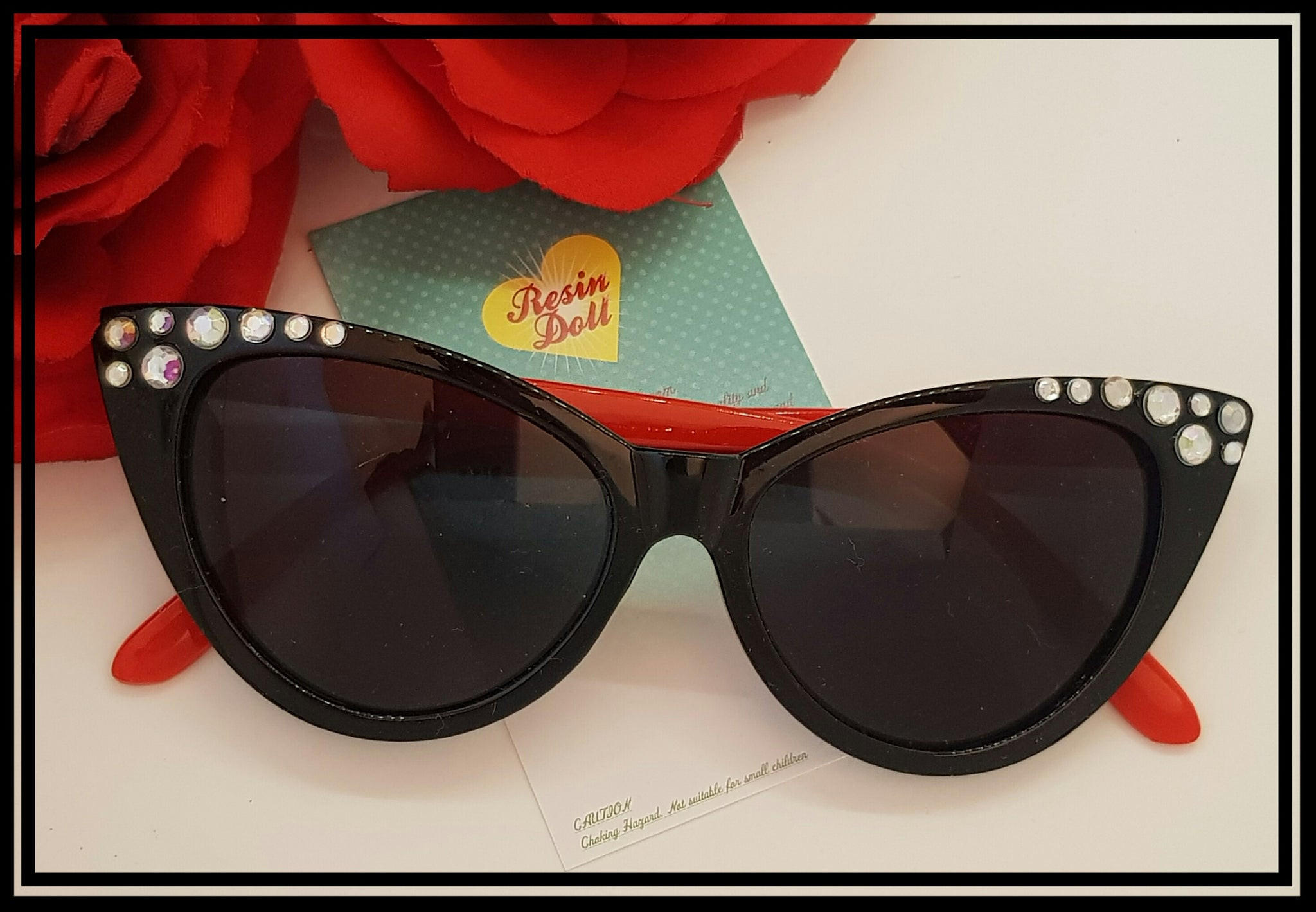 Black frame red arms sunglasses top bling