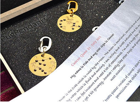 Star-sign PugPendants for luxury dogs from Canine Chic of London with gift scroll