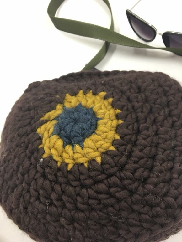 Round 100% wool brown bag with strap