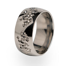 A stunning Titanium ring carved with dragons.