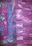 All Purples batiks quilted insulated log cabin table runner with a splash of color