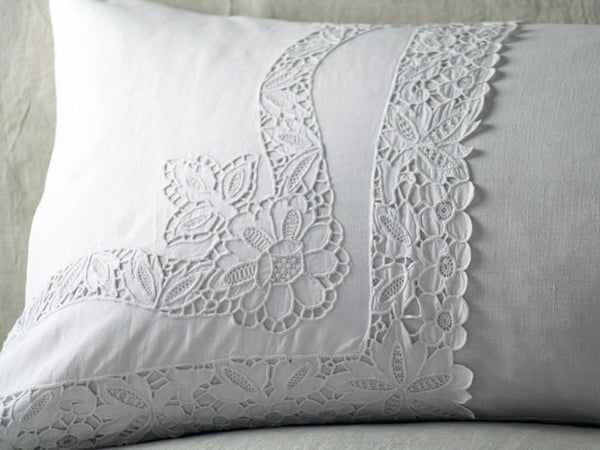 Bolsters - Antique embroidered thread work on linen bolster by Charlotte Casadéjus