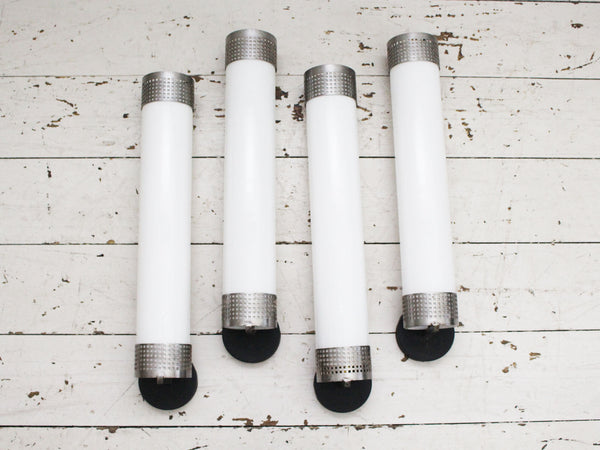 A Set of Four French Late Art Deco White Glass Wall Lights