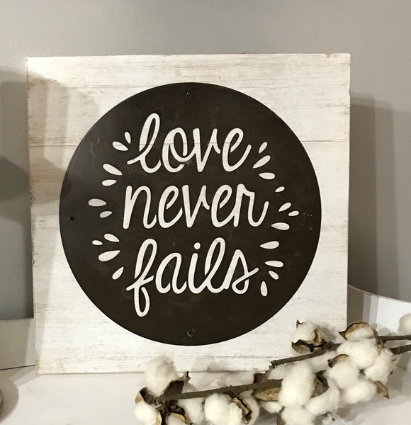 Love Never Fails Acid Wash Metal Disk and Wood Sign