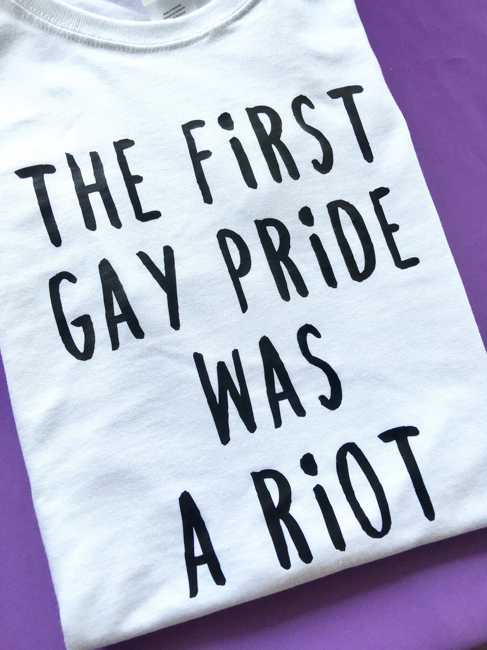 The first gay pride was a riot (white semi-fitted tee) - Radical Buttons