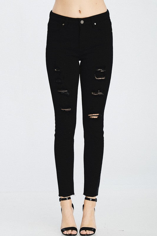 Distressed 5 pocket skinny jeans in black