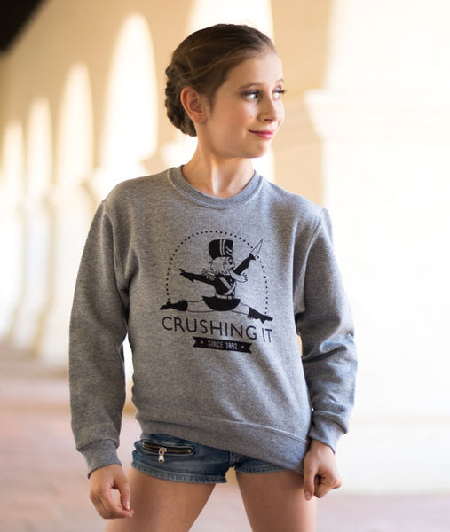 Crushing It Youth Nutcracker Sweatshirt on Elliana Walmsley
