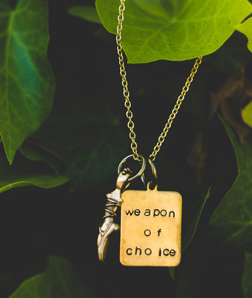 Vintage Pointe Shoe and Hand-Stamped Weapon of Choice charms on a necklace