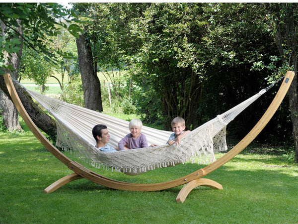 Father and two children in large hammock suspended from Arcus hammock stand