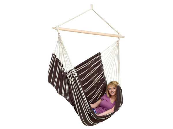 Woman sat sideways in Brasil Mocca Hammock Chair with white background.