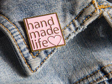Load image into Gallery viewer, handmade life love pink and gold enamel pin on denim jacket lapel