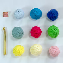 "Load image into Gallery viewer, You get nine colors of yarn to mix and match as you like, along with a gold aluminum crochet hook and a ""Handmade Life Love"" enamel pin."