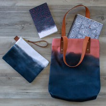Load image into Gallery viewer, unique handbag featuring indigo clouds and coral sunset design coordinates with our notebooks and zipper clutch bags
