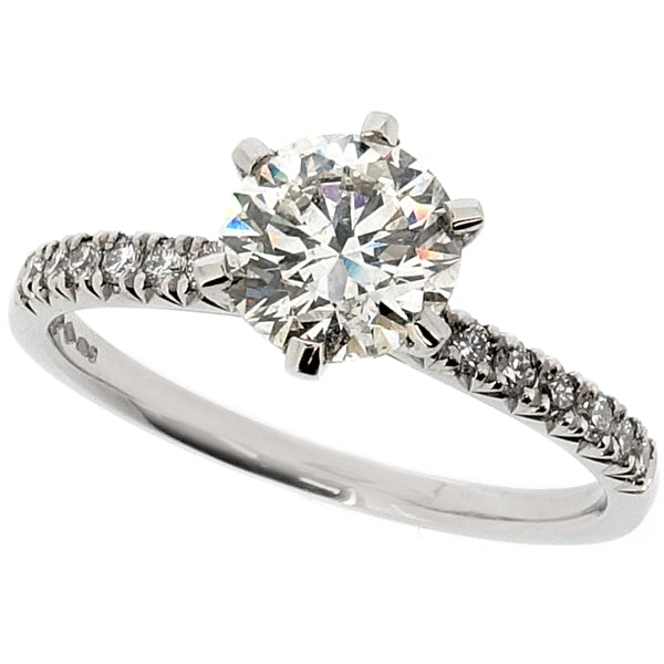 Brilliant cut diamond solitaire with diamond set shoulders in platinum, 1.20ct