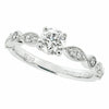 Diamond solitaire ring with diamond set shoulders in 18ct white gold, 0.68ct