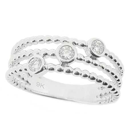 Diamond three stone dress ring in 9ct white gold, 0.15ct
