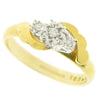 Illusion set diamond twist three stone ring in 9ct yellow gold, 0.04ct