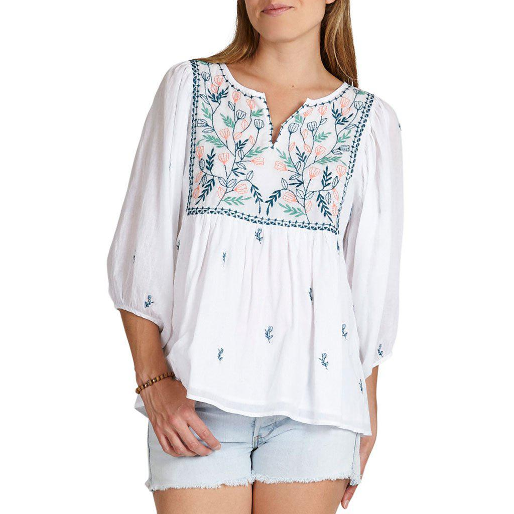Ava Bella top for women. White with floral embroidery. Front view.