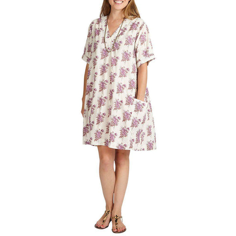 Women in lavendar floral Cheyenne Dress.