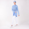 Woman in sky blue HAWA Step Tee with right arm crossed over her body and left leg popped.