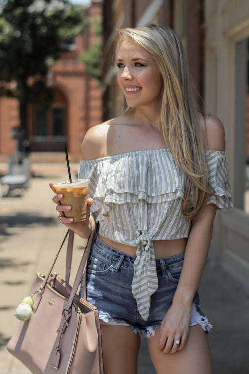 green and white striped off the shoulder top