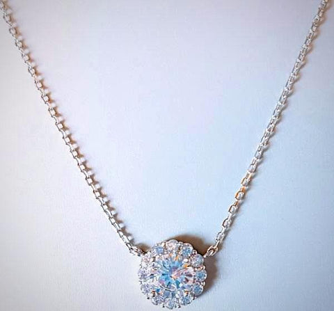 RN-832 Swarovski crystal in 925 sterling silver make for this delicate and showy pendant