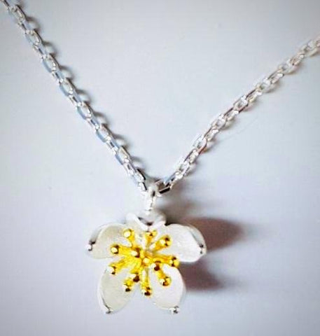 RN-830 Blooming flower pendant in lovely shades of gold and silver plating made with 925 sterling silver
