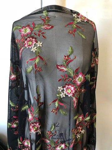 Poinsettia Embroidered Floral Stretch Mesh on Black. Designer End Bolt