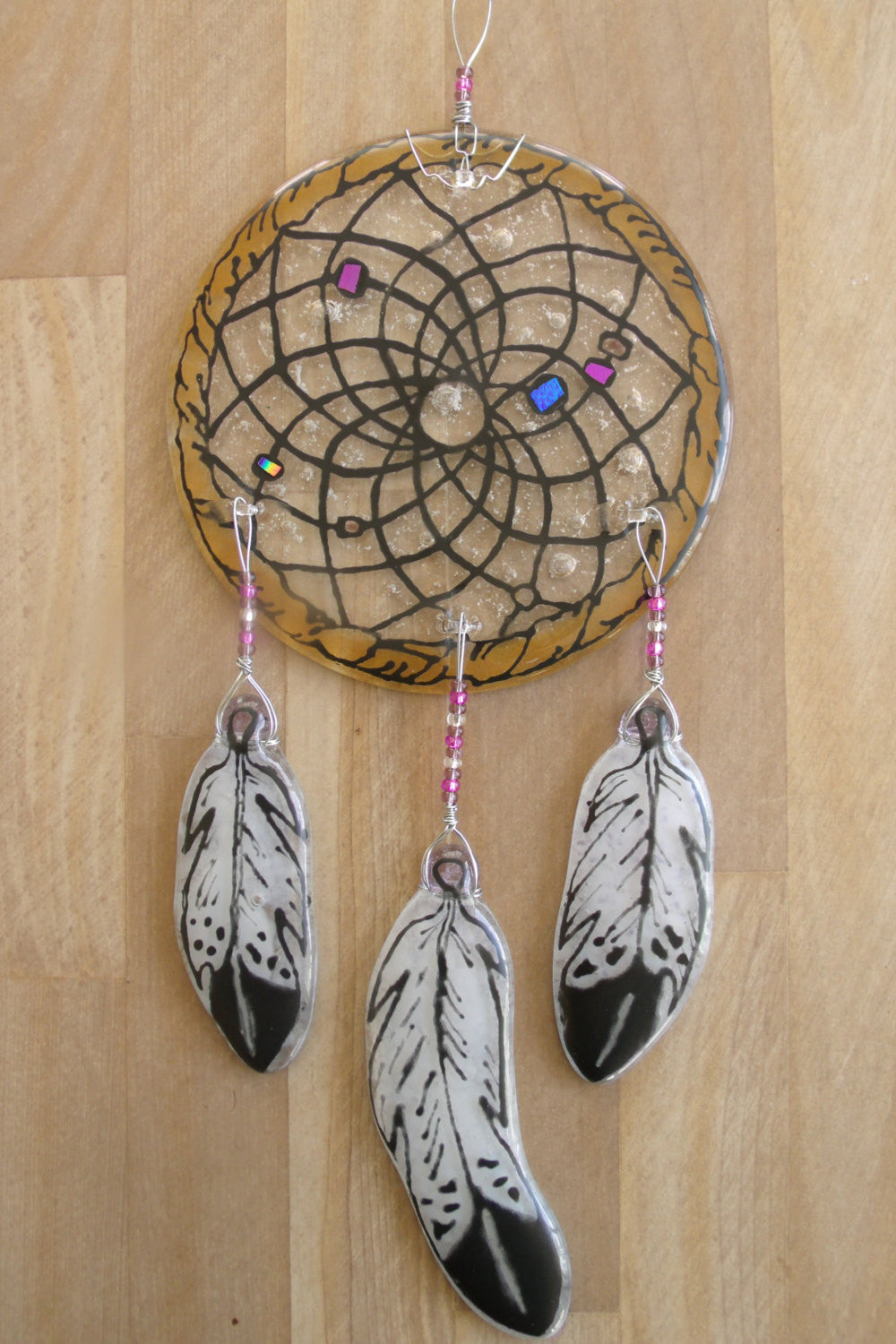 Cremation Memorial Sun Catcher Tags: cremation ashes glass art cremation ashes in glass cremation glass cremation memorial Cremation Memorial Sun Catcher Dream Catcher feather funeral glass dream catcher handmade human ashes memorial memorial glass memorial_art mourning native_american_art Spiritual urn