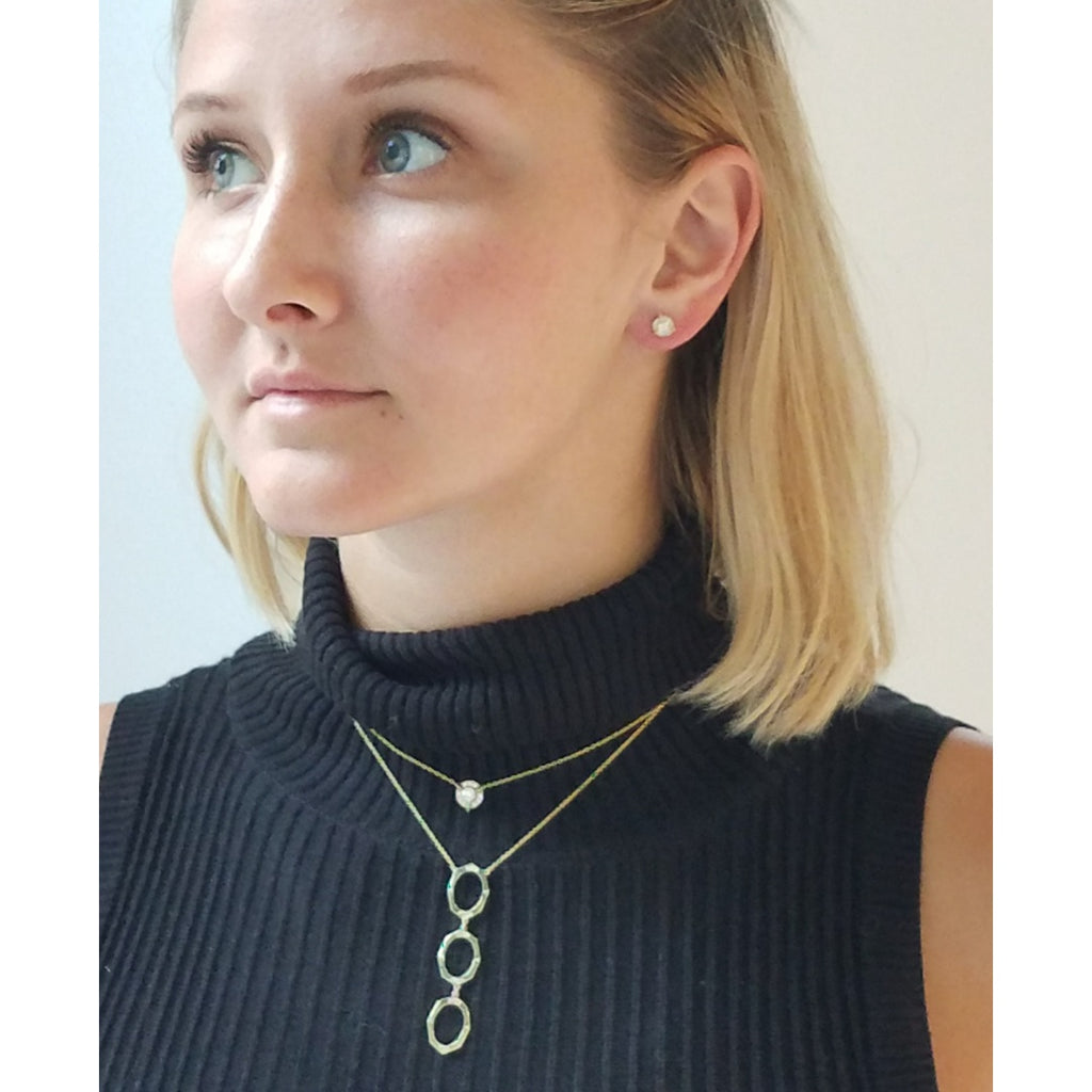 Three Drop Diamond Necklace in Yellow Gold Displayed on Model By Irthly