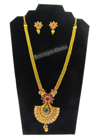 Antique gold styled and green kemp haaram Indian necklace and jhumkis