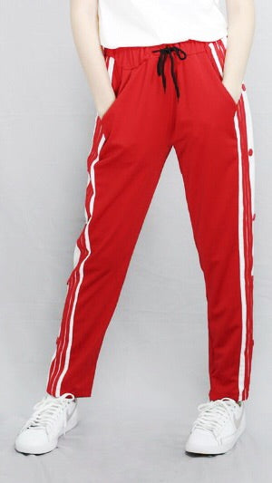 Red track pants with button accents
