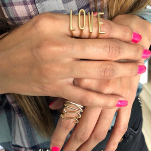women wearing initial letter custom ring