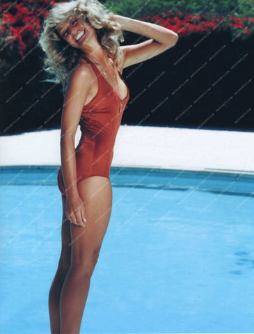 beautiful Farrah Fawcett in swimsuit by the swimming pool dp-9542