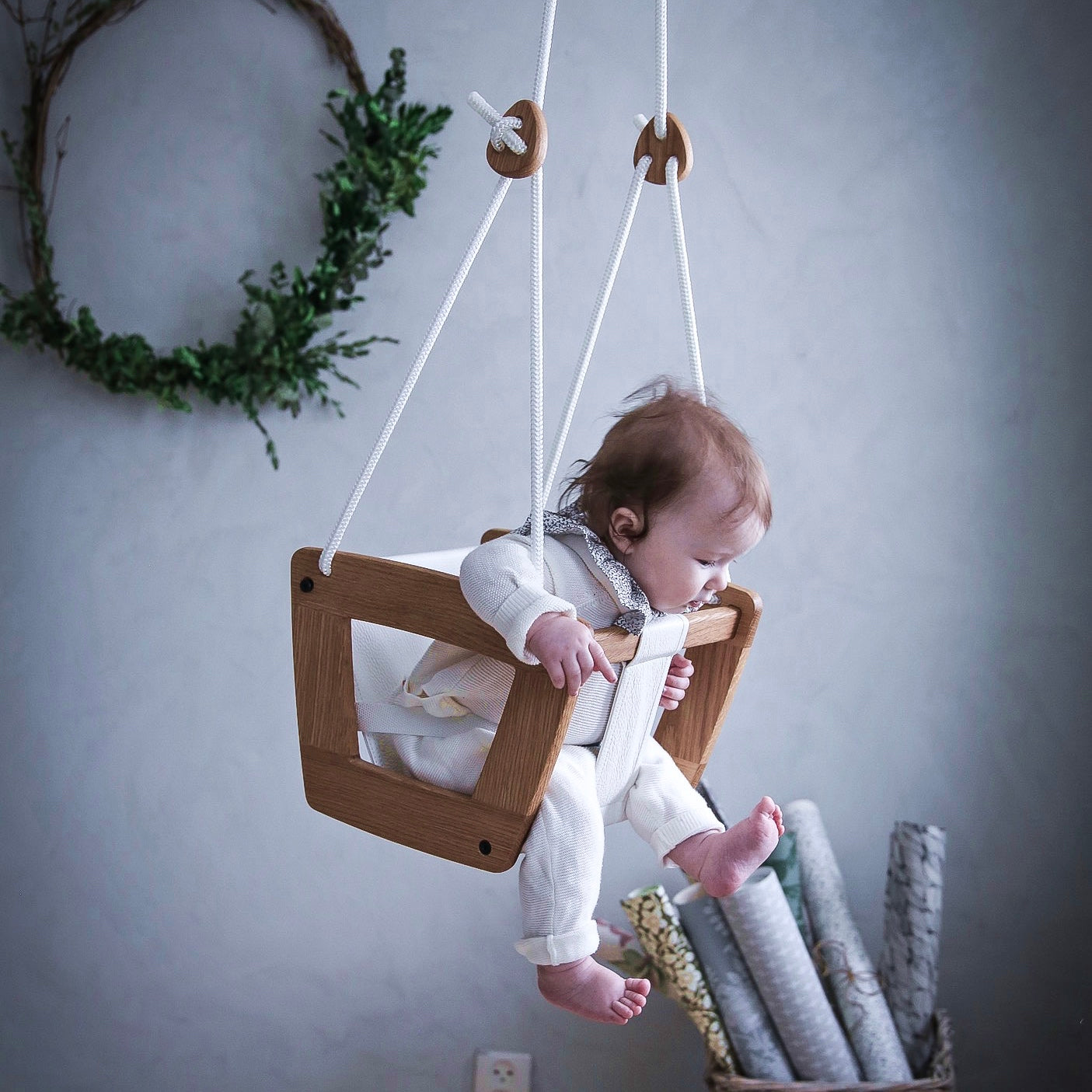 Lillagunga Toddler baby swing in wood with a genuine leather seat.