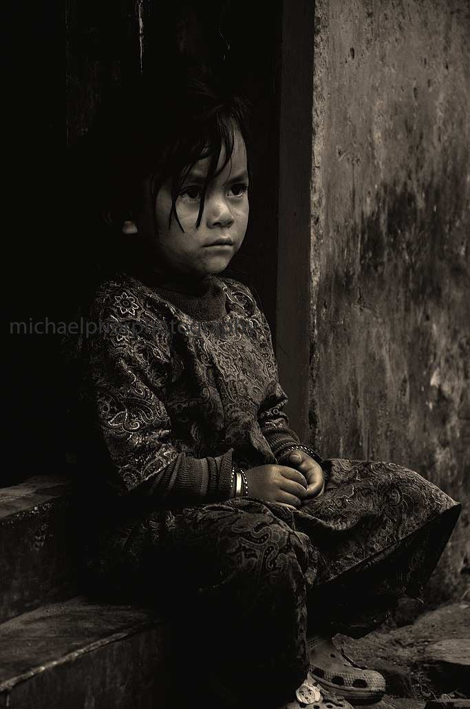 Nepalese Girl In A Doorway - Michael Prior Photography