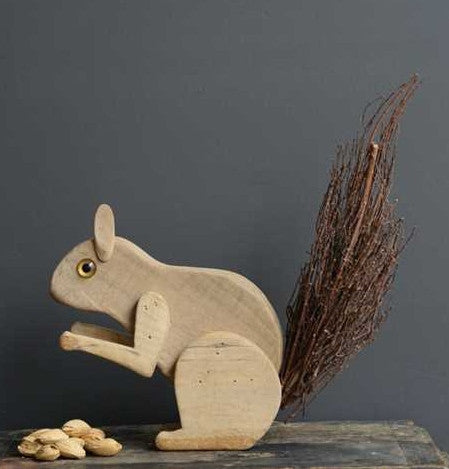 Wood Squirrel with Twig Tail
