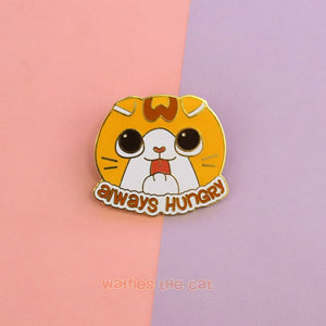 Enamel pin with cute Scottish Fold licking his paws