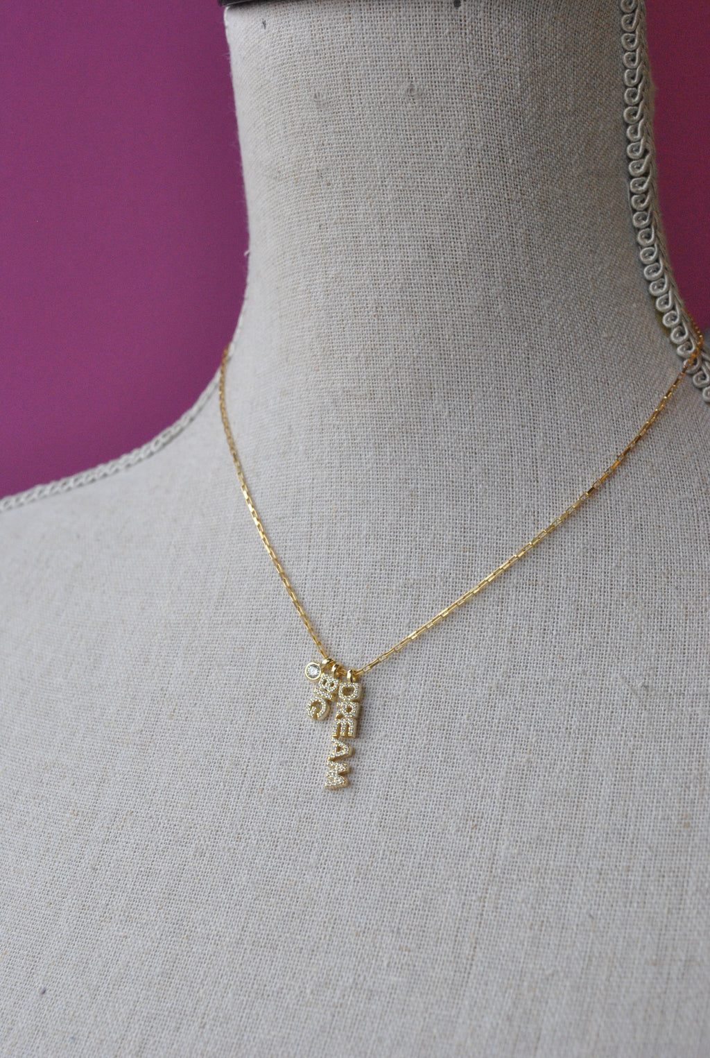 "GOLD DELICATE NECKLACE WITH A ""DREAM BIG"" PENDANT"