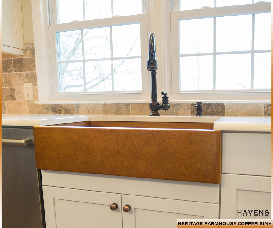 14 Gauge Copper farmhouse sink with a smooth patina apron front. USA made by Havens Luxury Metals