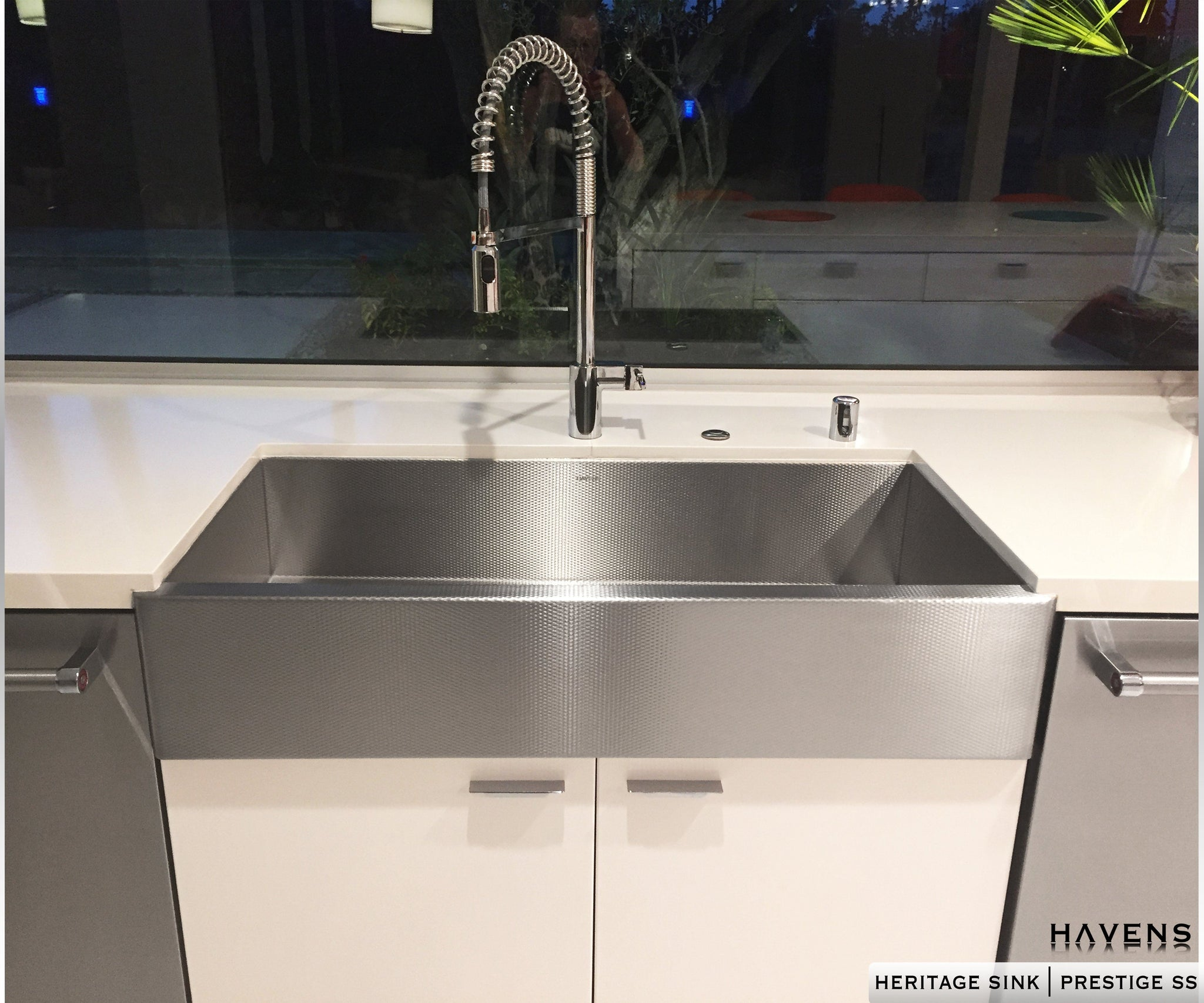 Textured stainless steel farmhouse style kitchen sink. Installed as an undermount, this stainless apron front sink is beautiful.