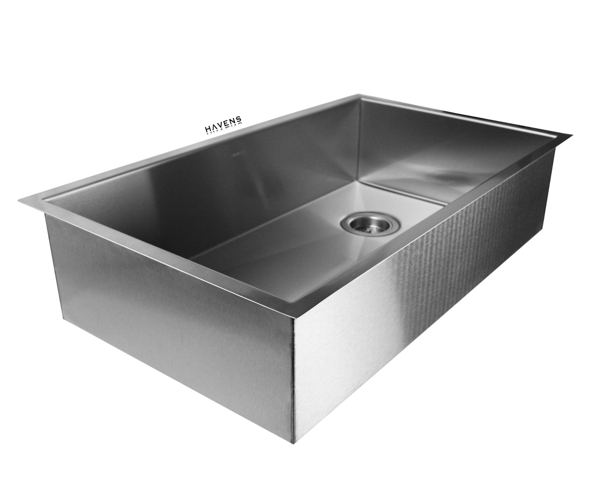 Stainless steel under mount sink with a right rear drain placement.