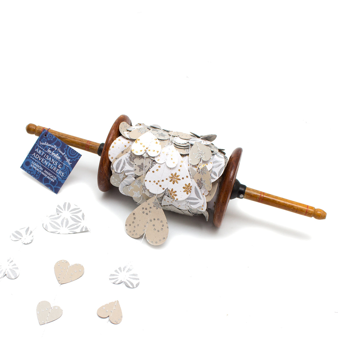 Wooden spool hand made using recycled paper in India with 25 meters of white, silver and gold hearts for wedding and christening decorations.