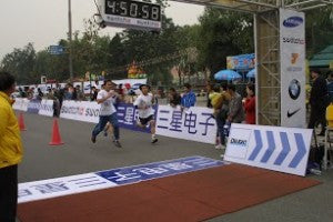 First timing service in China successfully finished in Beijing Marathon 2003