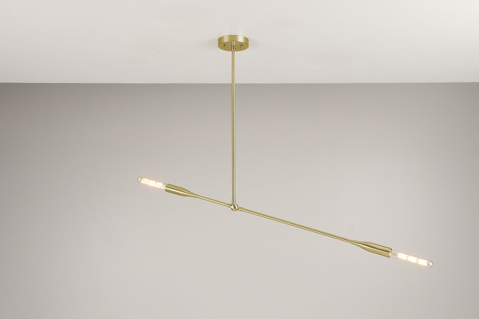 Mid-Century inspired Sorenthia Light fixture in Brushed Brass with linear bulbs by Studio DUNN with a grey wall background