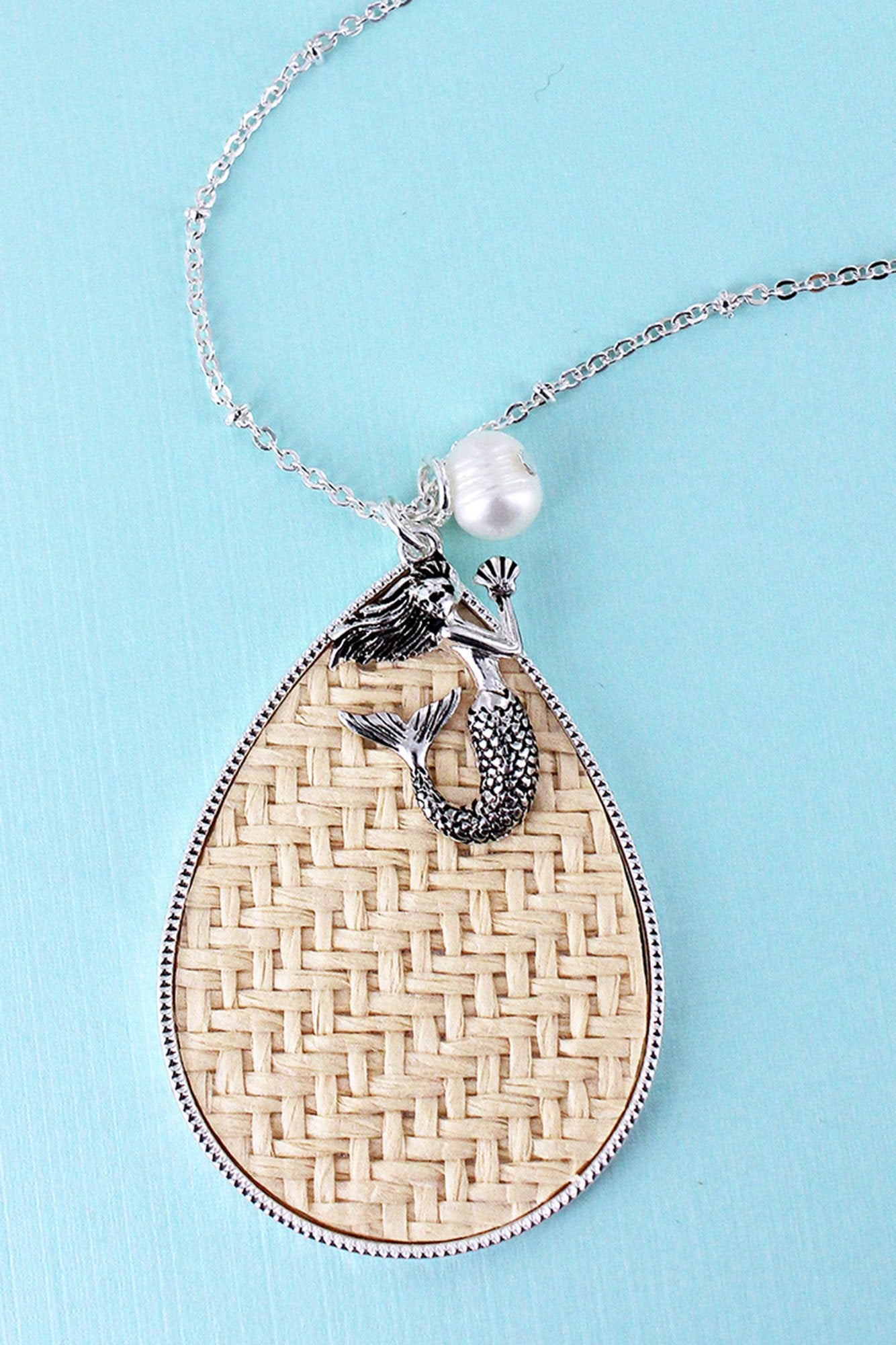 Ivory Rattan Teardrop with Silvertone Mermaid Pendant Necklace