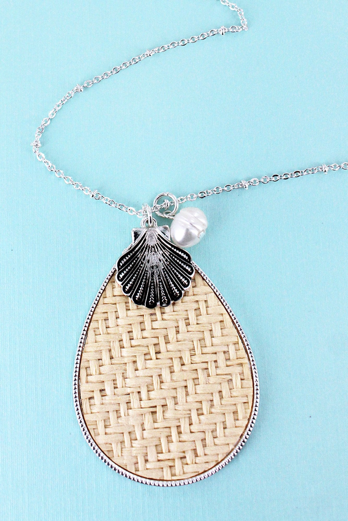 Ivory Rattan Teardrop with Silvertone Seashell Pendant Necklace