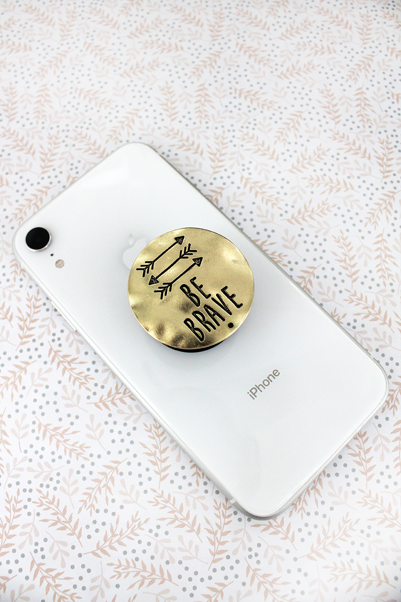 Worn Goldtone 'Be Brave' Disk Cell Phone Grip Cover