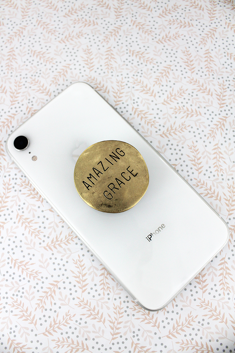 Worn Goldtone 'Amazing Grace' Disk Cell Phone Grip Cover